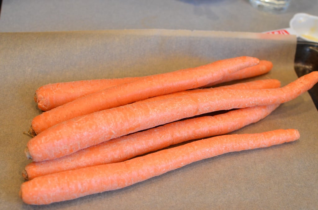 Bunch of carrots on parchment paper