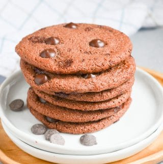 stack of chocolate peppermint cookies on a plate.