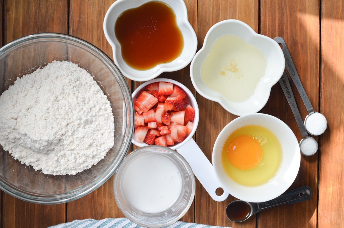 ingredients for strawberry muffins on counter.