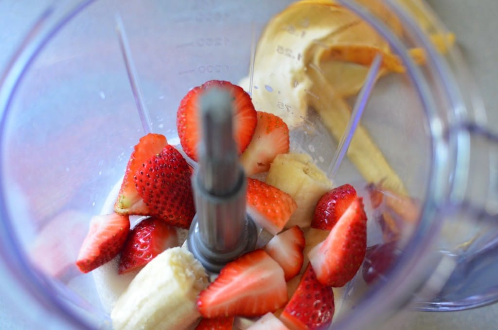 Sliced Strawberries and Bananas in The Blender - 24 Carrot Kitchen
