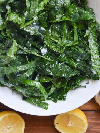 kale salad in a white bowl.