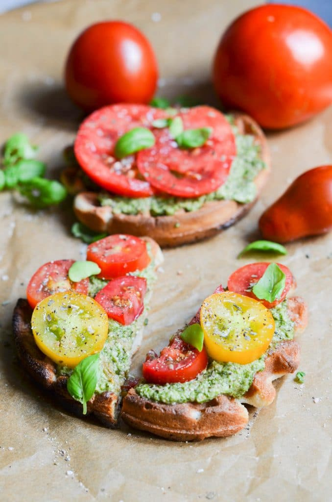 Dairy-free pesto on waffles with sliced tomatoes.