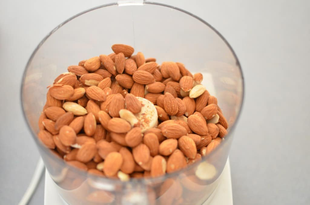 Easy Homemade Almond Butter - nuts in food processor -24 Carrot Kitchen
