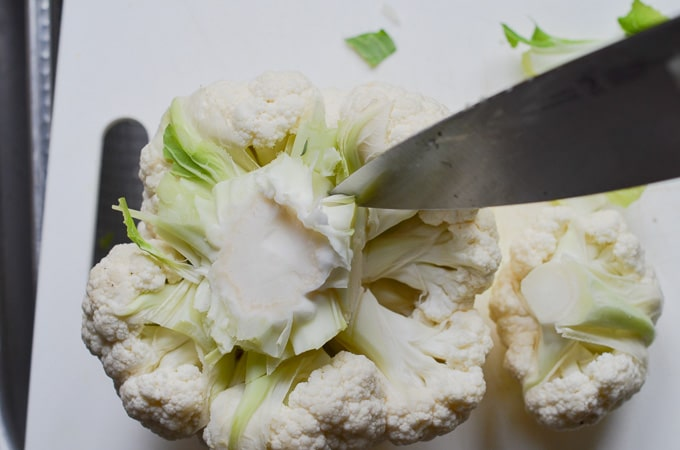 cutting cauliflower pieces.