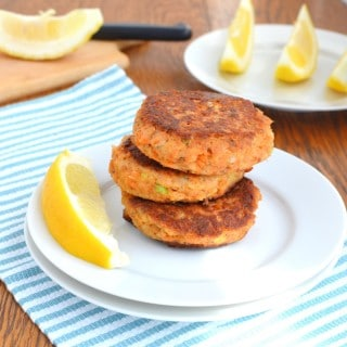 Paleo Salmon Cakes stacked on a plate - 24 Carrot Kitchen