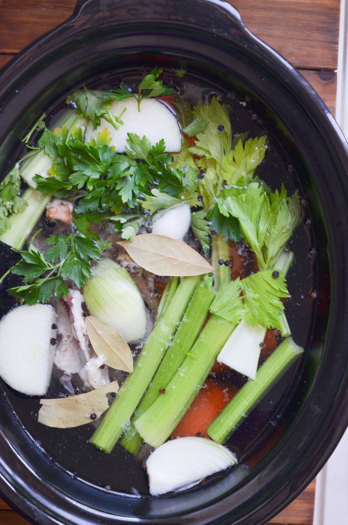 ingredients for chicken bone broth in slow cooker.