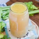 Chicken bone broth in glass jar.