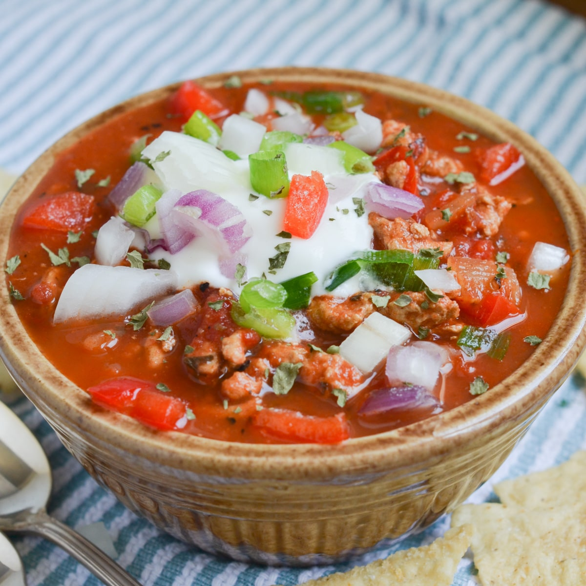 turkey chili in a bowl with toppings.