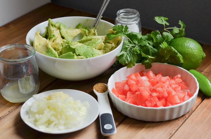 ingredients for guacamole on counter.