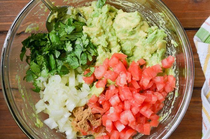 ingredients for guacamole in a bowl.
