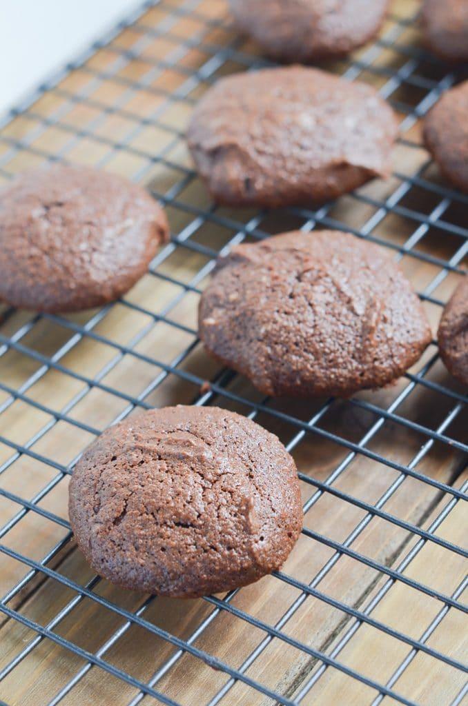 chocolate fudge cookies baked on cooling rack.