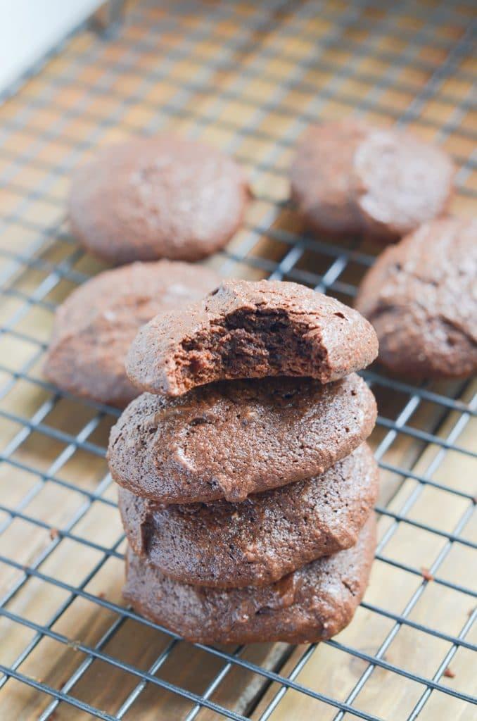 chocolate fudge cookies on cooling rack.