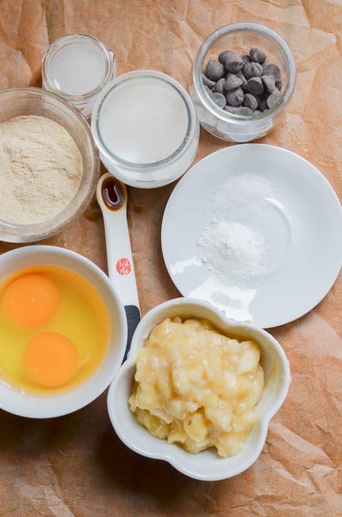 Ingredients for coconut flour muffins in bowls on counter.