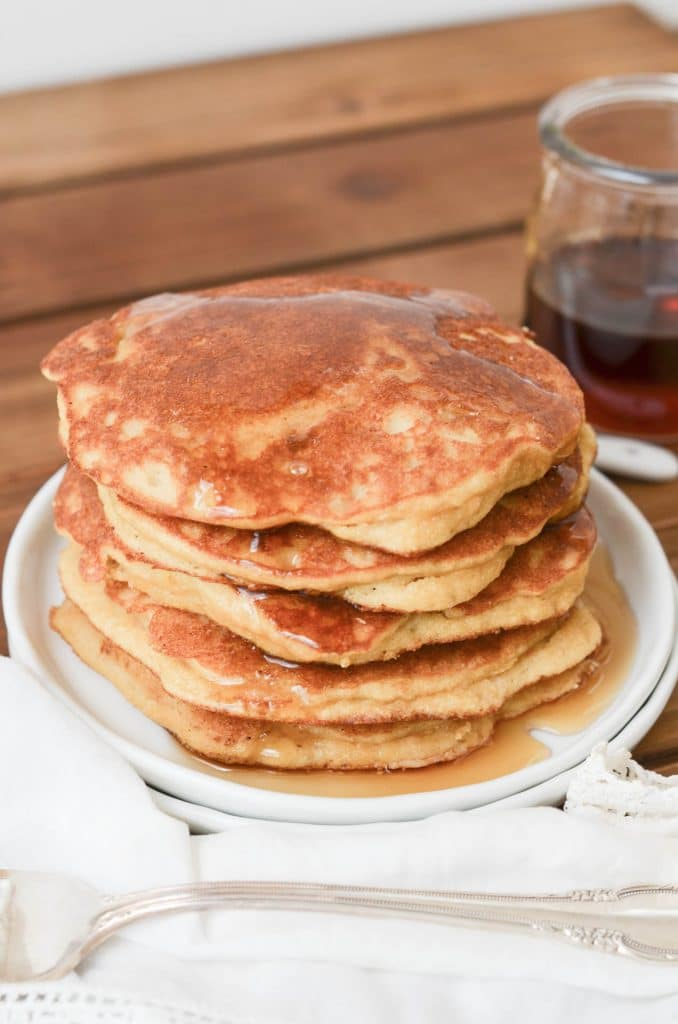 Paleo Coconut Flour Pancakes with syrup  on a plate.