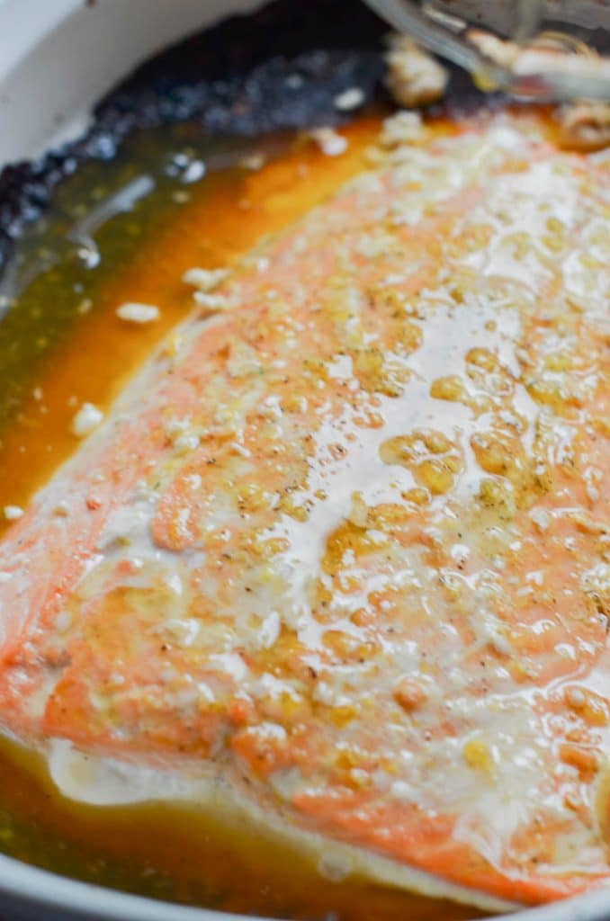 orange glazed salmon in casserole dish out of oven.