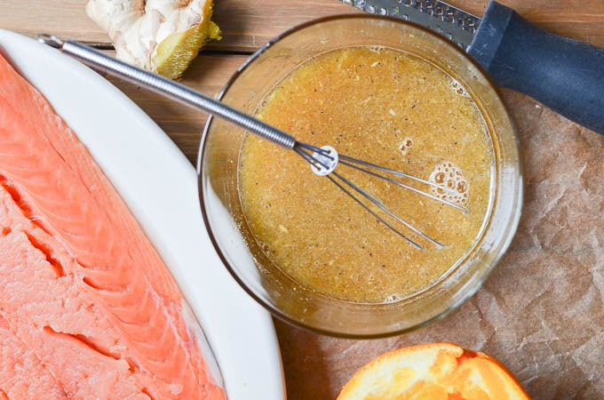 salmon and orange glaze in bowl on counter.