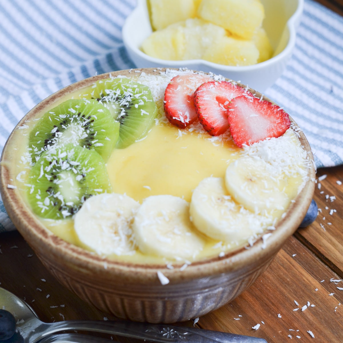 mango smoothie bowl with toppings.