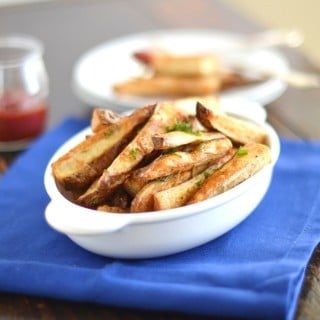 Roasted Rosemary Russet Potato Wedges - Easy, pub-style potato wedges with a few simple ingredients! 24 Carrot Kitchen