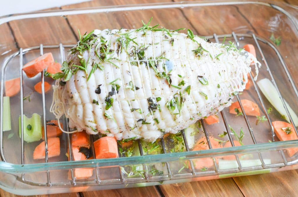 herb mixture is all over boneless turkey breast.
