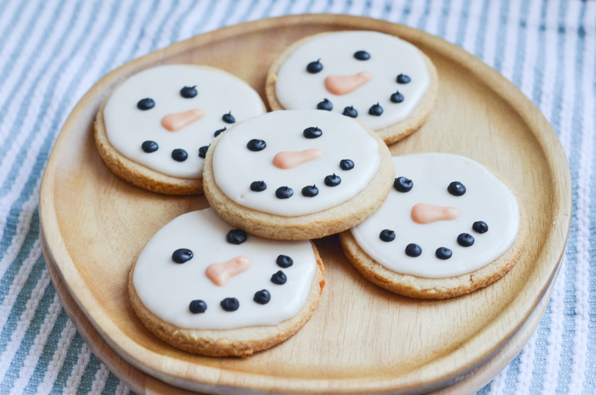 vegan Sugar Cookies Snowmen decorated on plate.