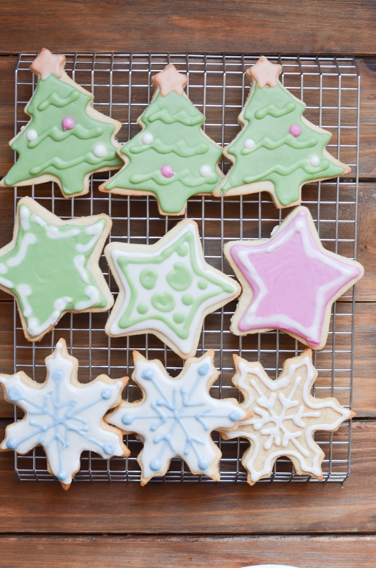 vegan sugar cookies decorated on cooling rack.