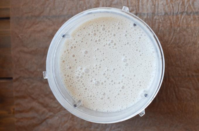 dairy-free eggnog in blender cup.
