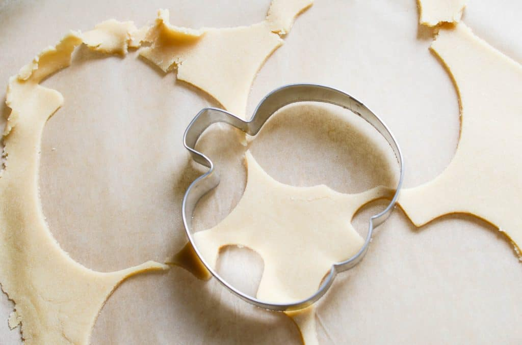 vegan Sugar Cookies cut out with cookie cutter - 24 Carrot Kitchen