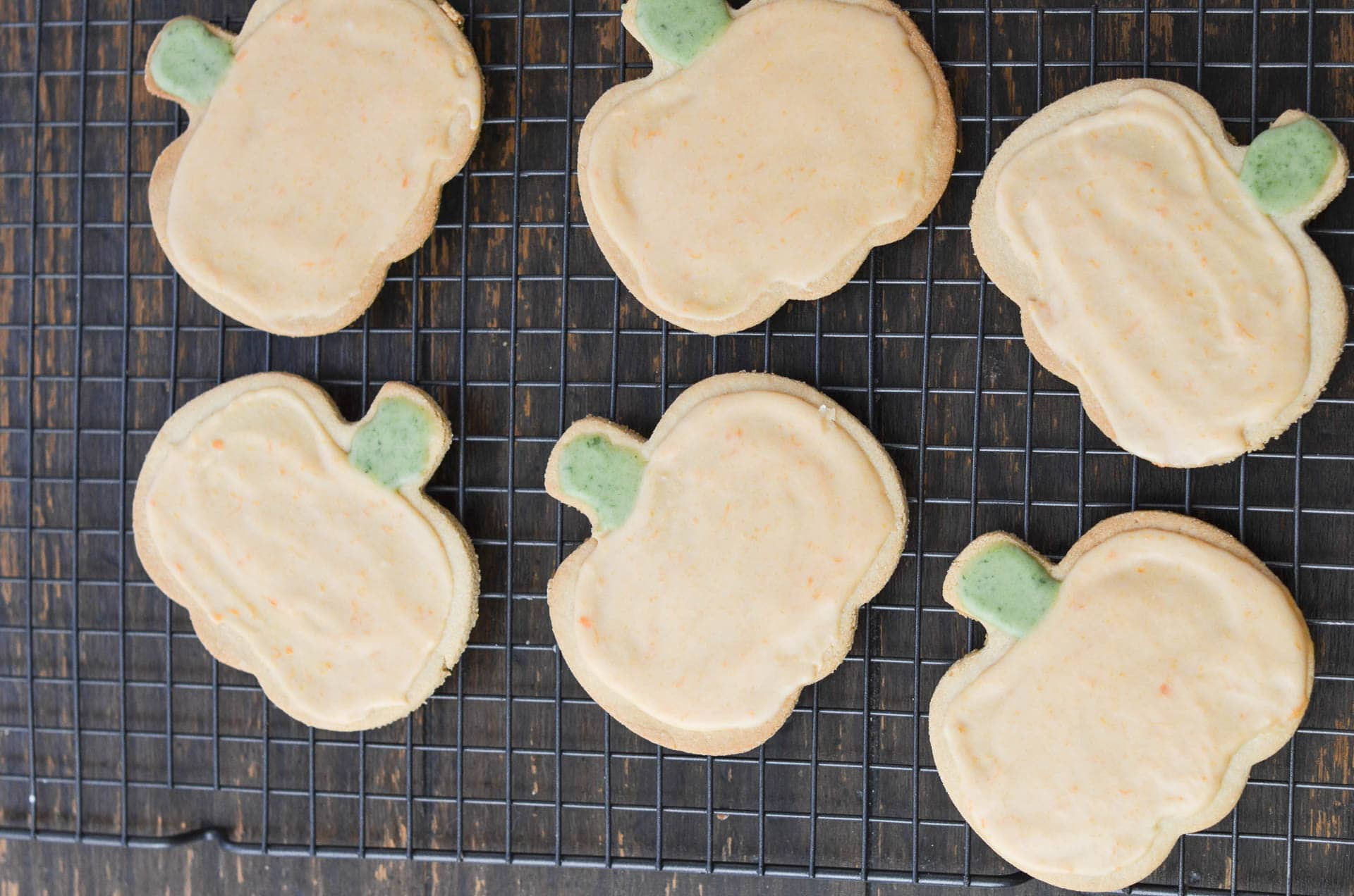 vegan sugar cut out cookies decorated on cooling rack.