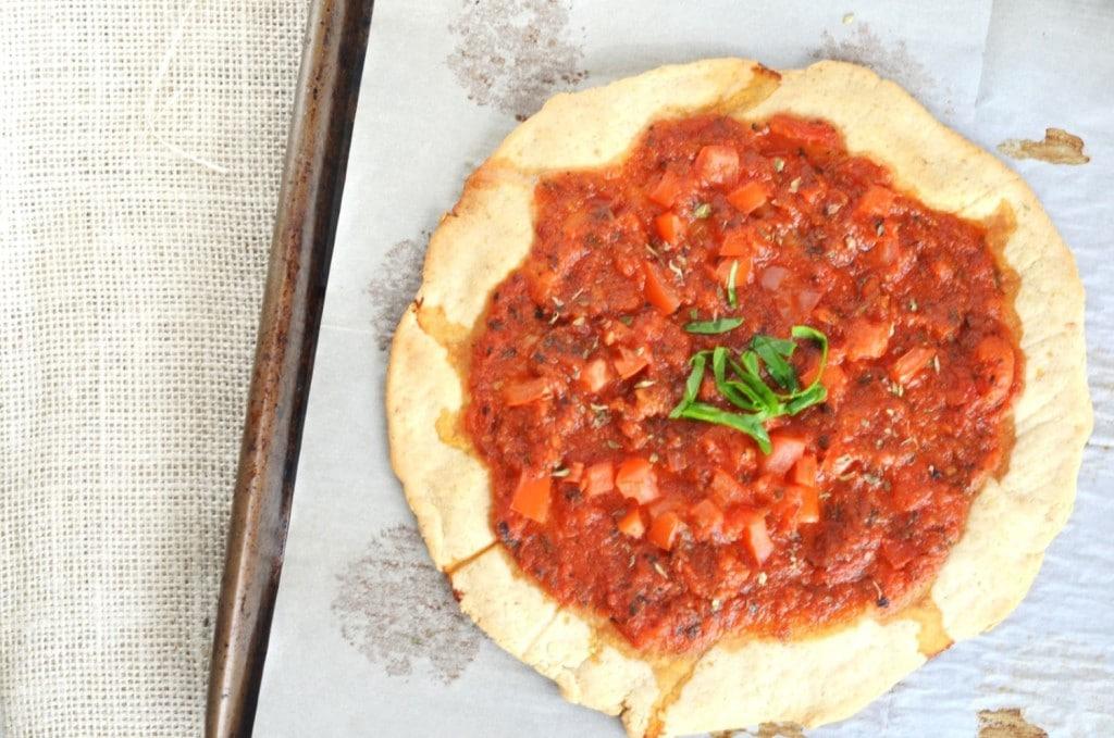 Gluten Free Pizza Crust on baking pan - 24 Carrot Kitchen
