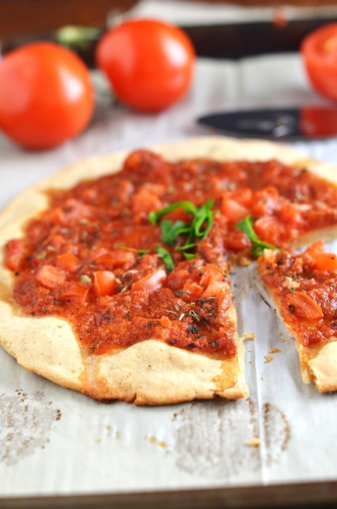 Gluten-Free Pizza Crust on baking sheet - 24 Carrot Kitchen