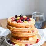 Paleo Waffles on a plate with berries - 24 Carrot Kitchen