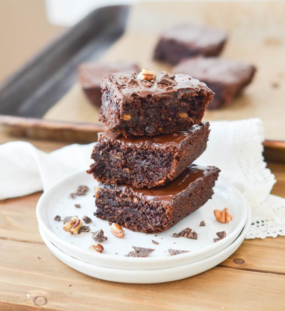 Gluten-Free Vegan Brownies stacked on plate - 24 Carrot Kitchen