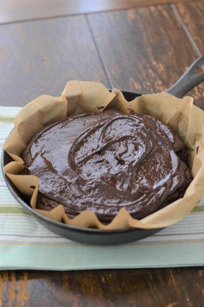 Paleo Chocolate Cake with Icing In Skillet - 24 Carrot Kitchen