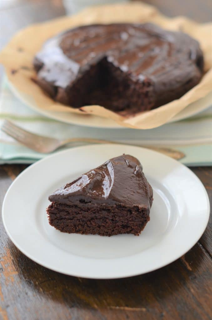Slice of Paleo Chocolate Cake with Dairy Free Chocolate Ganache Icing - 24 Carrot Kitchen