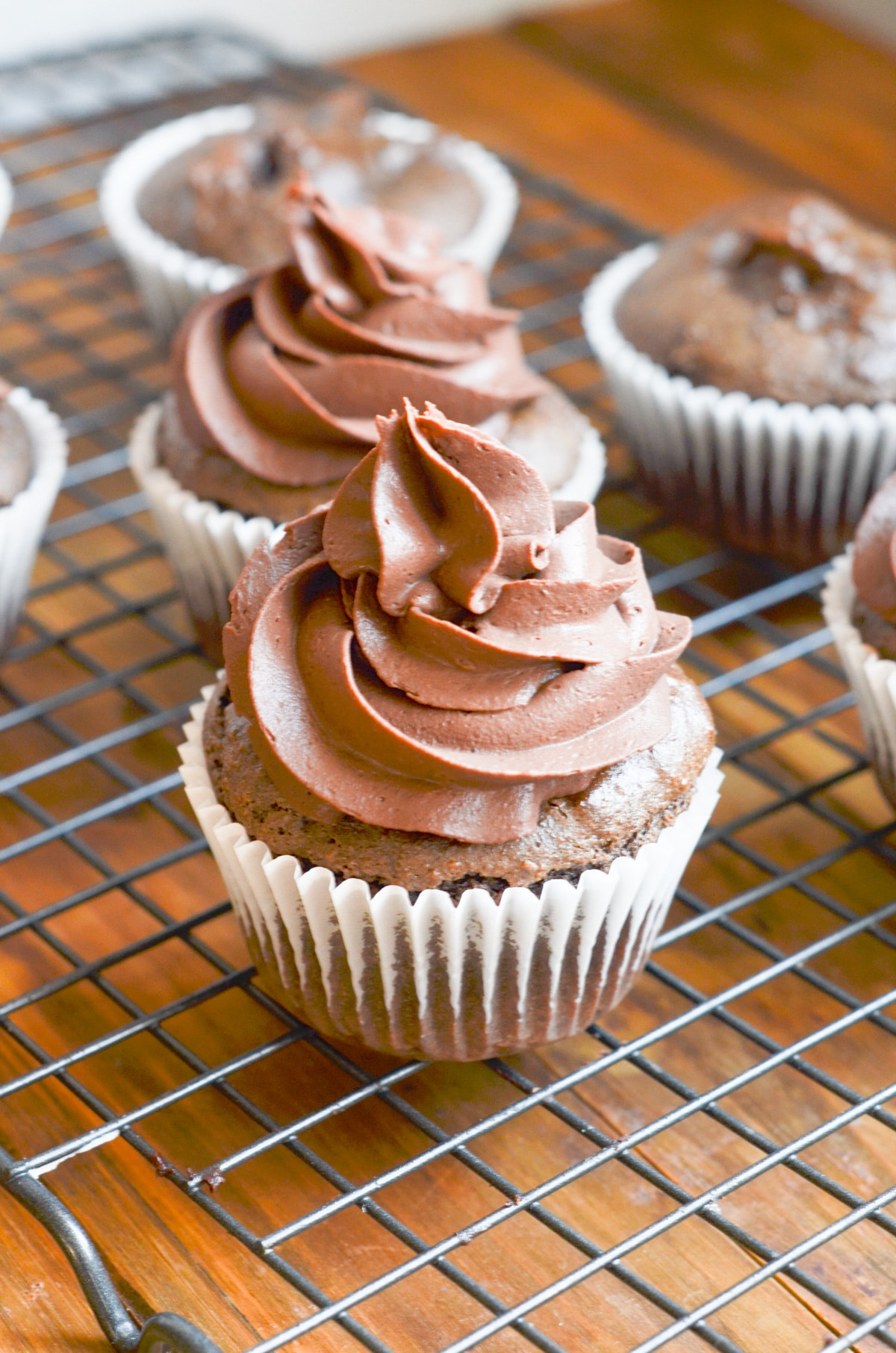 Paleo chocolate cupcakes with chocolate frosting.