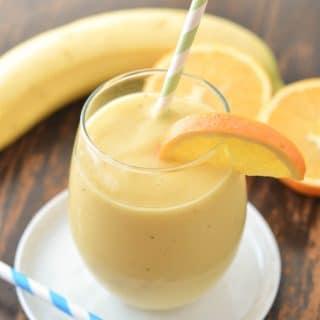 Mango Orange Smoothie in a glasss - 24 Carrot Kitchen