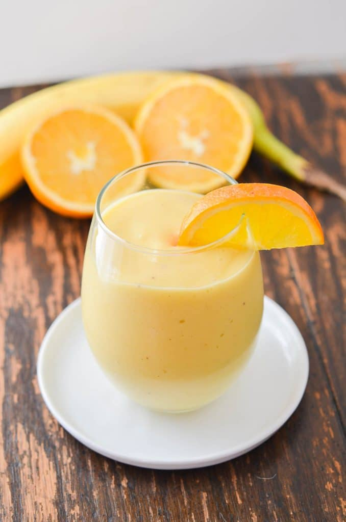 Mango Smoothie in a glass- 24 Carrot Kitchen