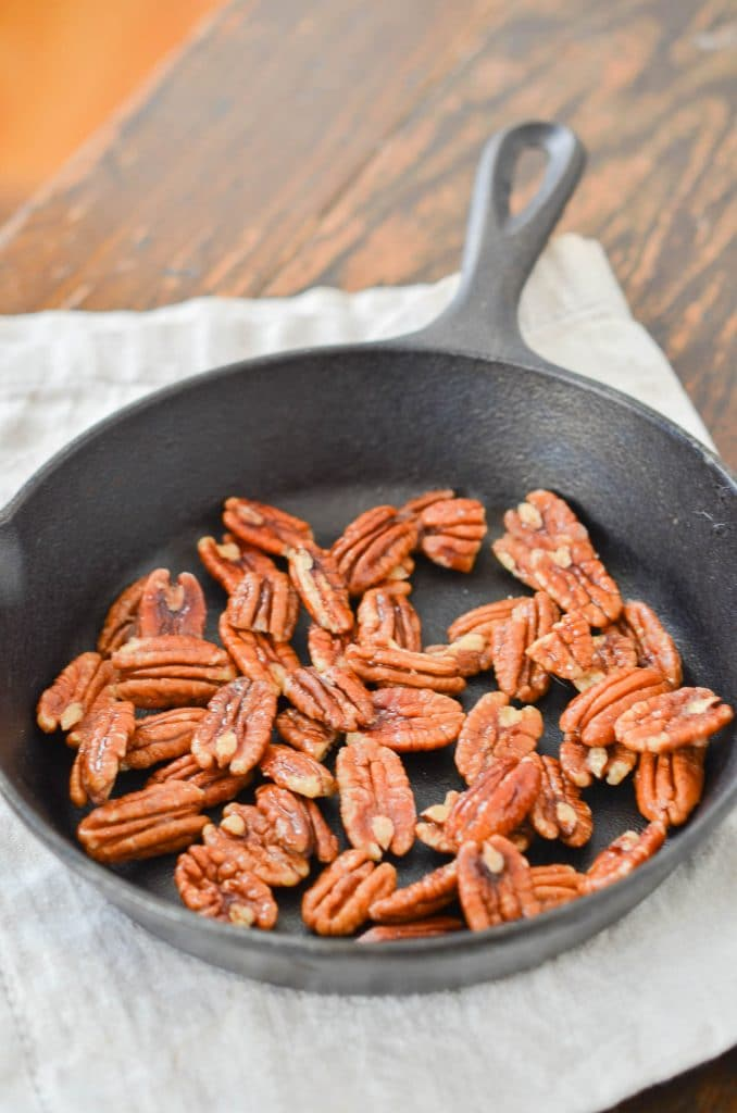 Maple Pecans in cast iron skillet - 24 Carrot Kitchen