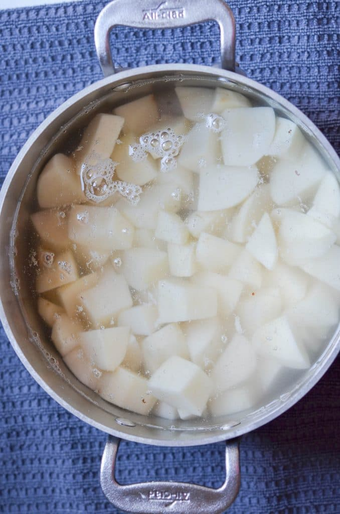 Cut Potatoes cubes in pot with water - 24 carrot kitchen