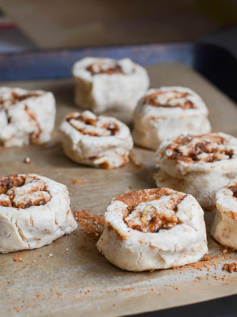 vegan cinnamon rolls on baking pan ready for oven - 24 Carrot Kitchen