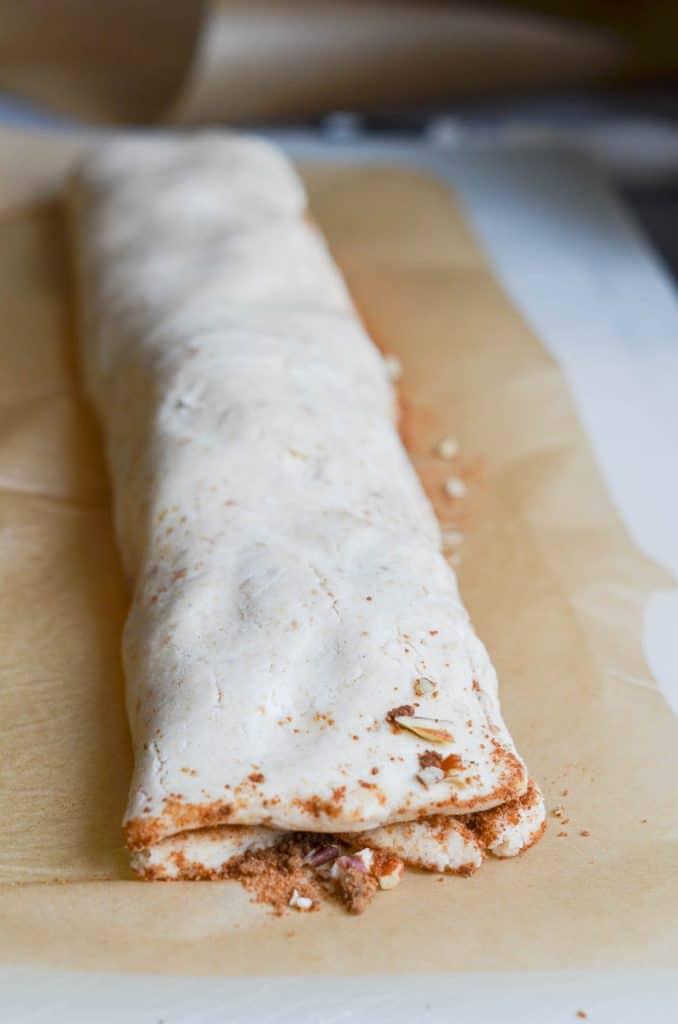 vegan cinnamon rolls dough in a roll - 24 Carrot Kitchen