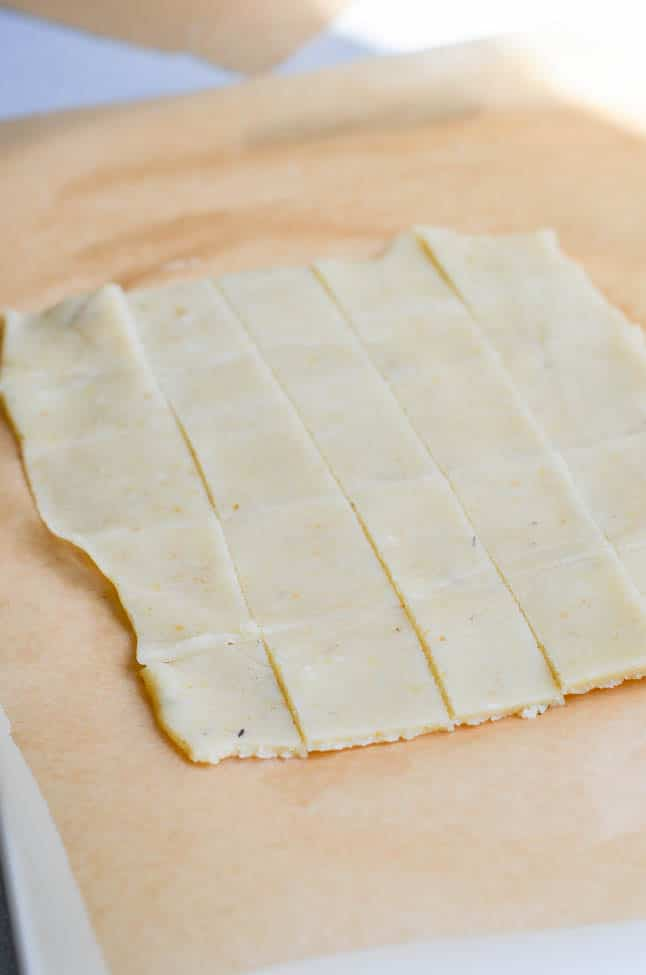 Paleo cracker dough rolled out and cut in squares - 24 Carrot Kitchen