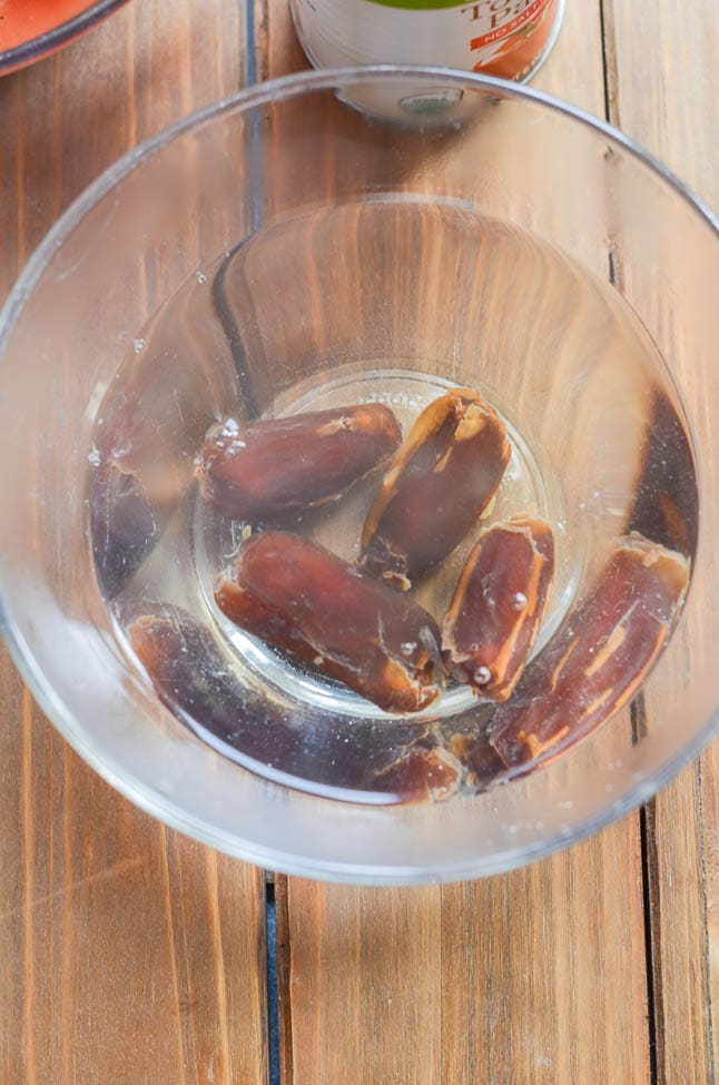 Pitted dates in a bowl with boiling water. - 24 Carrot Kitchen