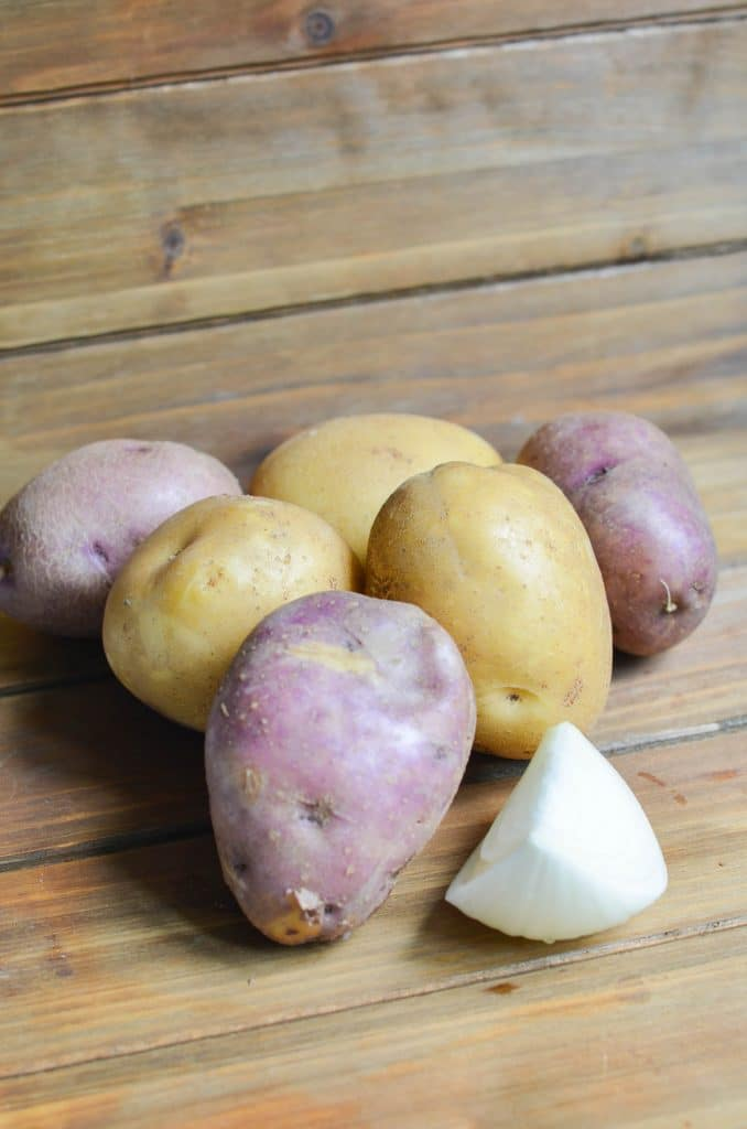 Six potatoes and onion needed for recipe.