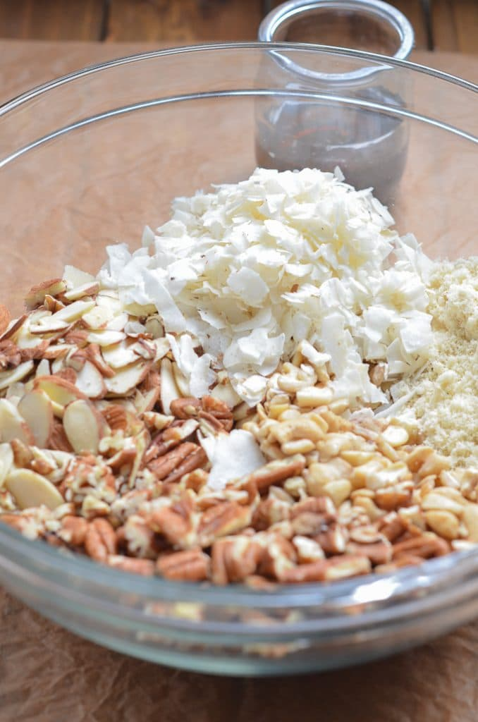 ingredients for vegan granola in glass mixing bowl.