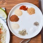 Whole30 spices on a round plate.