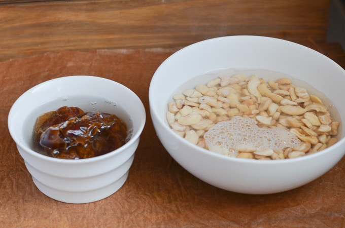 bowl of cashews and dates covered in hot water.