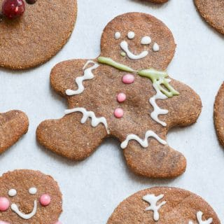 Decorated vegan gingerbread cookies on baking sheet.