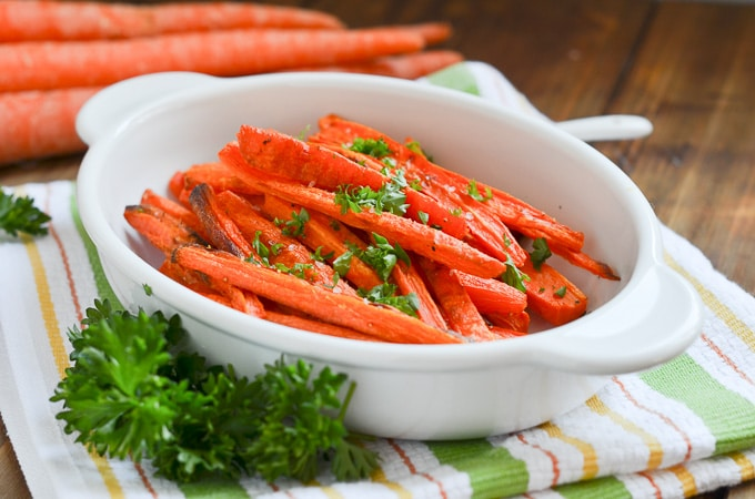 baked carrot fries on plate.