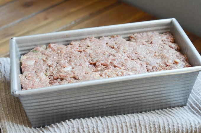 Paleo meatloaf in loaf pan.